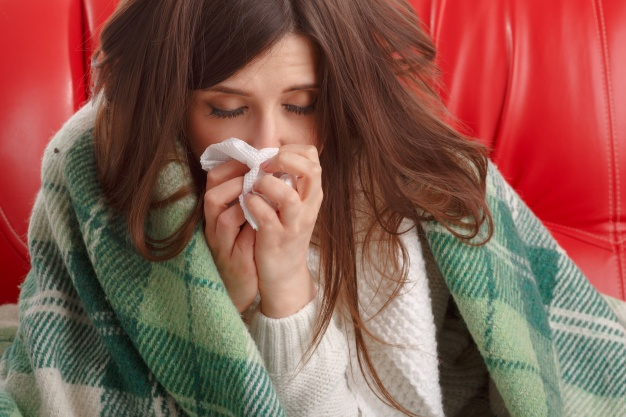 close-up-of-ill-teenager-with-a-tissue-next-to-her-nose_1208-33